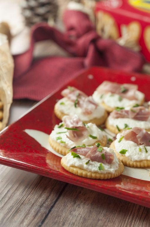 Whipped Ricotta Prosciutto Cracker Bites are the perfect Christmas Eve appetizer recipe or New Year's Eve appetizer that comes together in no time at all and is so easy to make!