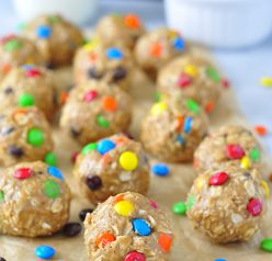 No-Bake Monster Cookie Dough Energy Bites are a gluten-free recipe suitable for a snack or dessert that will satisfy your sweet tooth without being loaded with sugar!