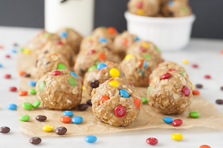 Healthy No-Bake Monster Cookie Dough Energy Bites are a gluten-free recipe suitable for a snack or dessert that will satisfy your sweet tooth without being loaded with sugar!