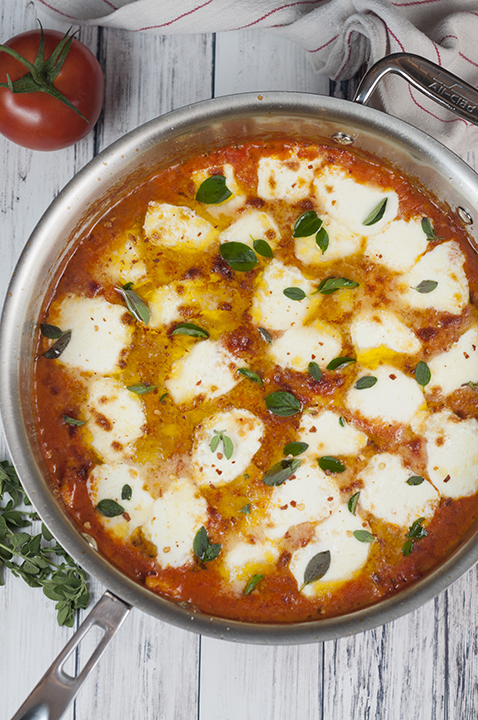 This Ravioli al Pomodoro recipe is an easy Italian one skillet meal made with San Marzano tomatoes, fresh mozzarella cheese, and absolutely packed with flavor!