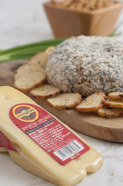Get the holiday party started with this Everything Bagel Cheese Ball recipe: all the flavors of your favorite everything bagel turned into a delicious cheese ball appetizer! Serve it with bagel chips and watch it disappear.