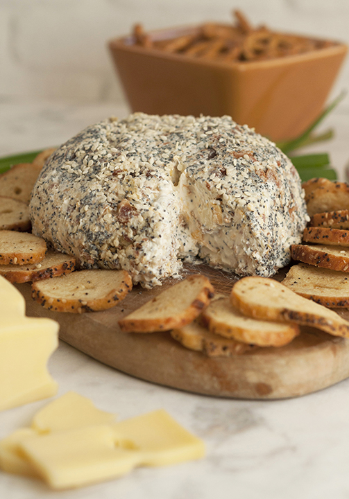 Get the Super Bowl, Christmas, or holiday party started with this Everything Bagel Cheese Ball recipe: all the flavors of your favorite everything bagel turned into a delicious, easy cheese ball appetizer! Serve it with bagel chips or pretzels!