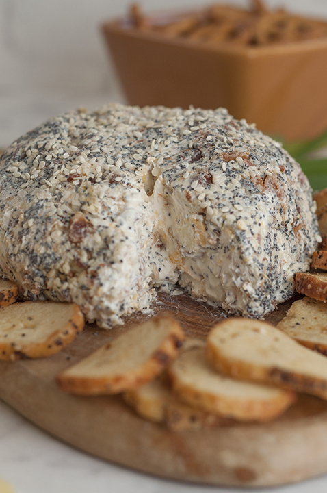 Get the party started with this Everything Bagel Cheese Ball recipe: all the flavors of your favorite everything bagel turned into a delicious cheese ball appetizer! Serve it with bagel chips and watch it disappear.
