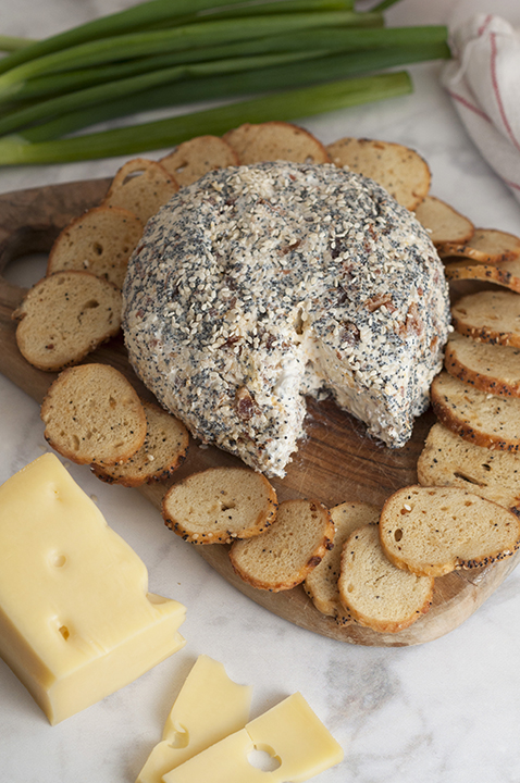 Get the Super Bowl, Christmas, Easter, or holiday party started with this Everything Bagel Cheese Ball recipe: all the flavors of your favorite everything bagel turned into a delicious, easy cheese ball appetizer! Serve it with bagel chips, crackers or pretzels!