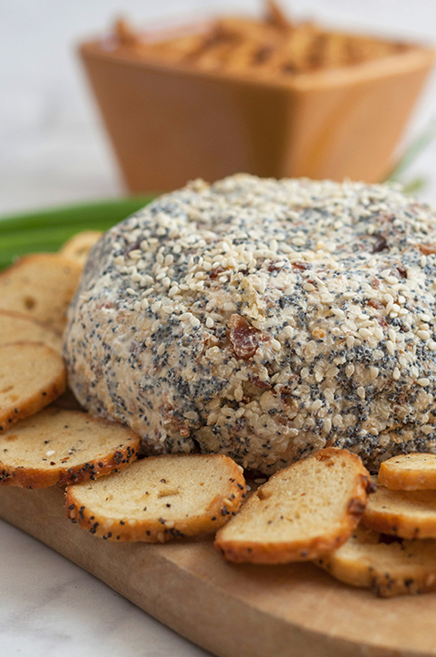 Get the Super Bowl, Christmas, or holiday party started with this Everything Bagel Cheese Ball recipe: all the flavors of your favorite everything bagel turned into a delicious cheese ball appetizer! Serve it with bagel chips and watch it disappear.