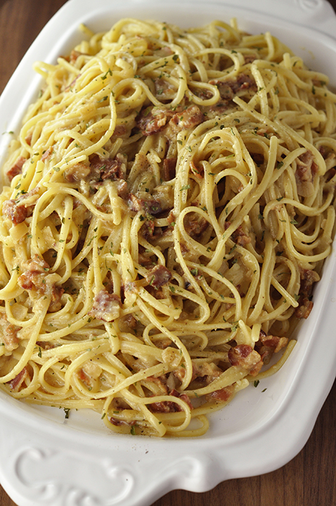Authentic Italian Pasta Carbonara recipe exactly how they make it in Rome, Italy! The eggs give it the silky, creamy texture this pasta dish is known for without all of the heavy cream.