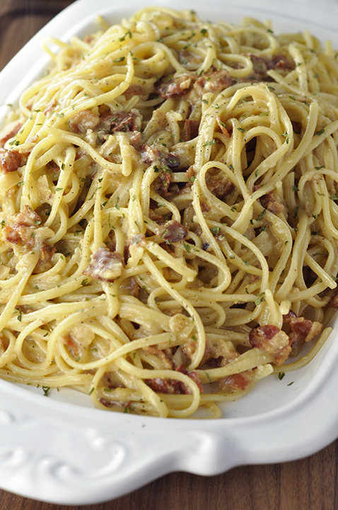 Authentic Italian Pasta Carbonara recipe exactly how they make it in Rome! The eggs give it the silky, creamy texture this pasta dish is known for without all of the heavy cream.