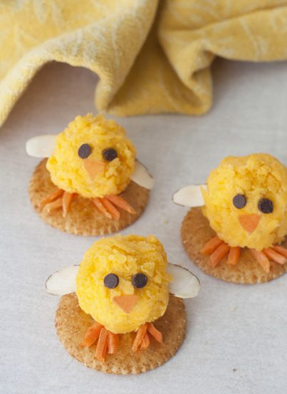 Baby Chick Mini Cheese Balls recipe would be the cutest addition to your holiday table for an Easter appetizer idea or a fun snack idea! They are so easy to make and perfect for adults and kids to eat on the Easter holiday.