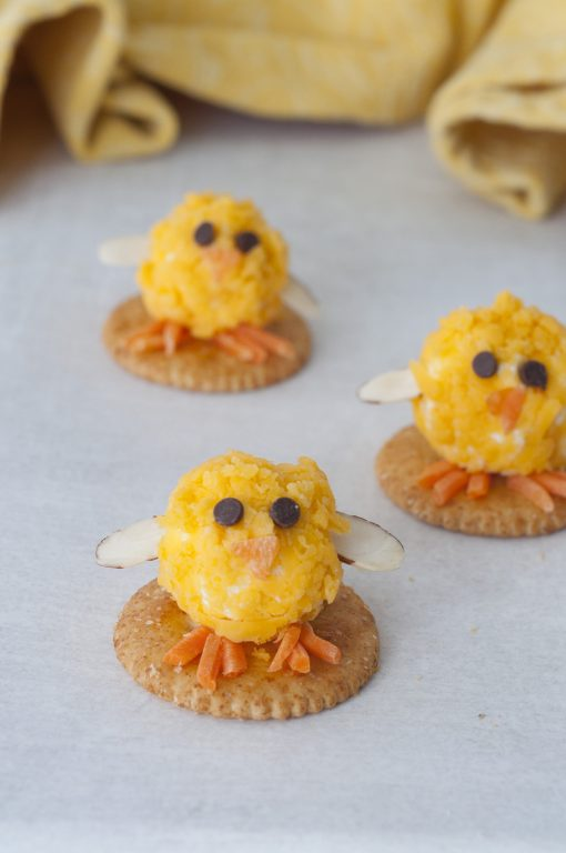Baby Chick Mini Cheese Balls recipe with bacon bits would be the cutest addition to your holiday table for an Easter appetizer idea or a fun snack idea! They are so easy to make and perfect for adults and kids to eat on the Easter holiday.