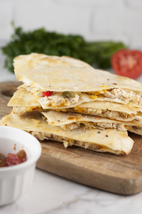 Chicken Fajita Quesadillas are the perfect weeknight meal recipe and great for Mexican food night! They're so easy to make right at home and you'll love this variation of the traditional quesadilla.