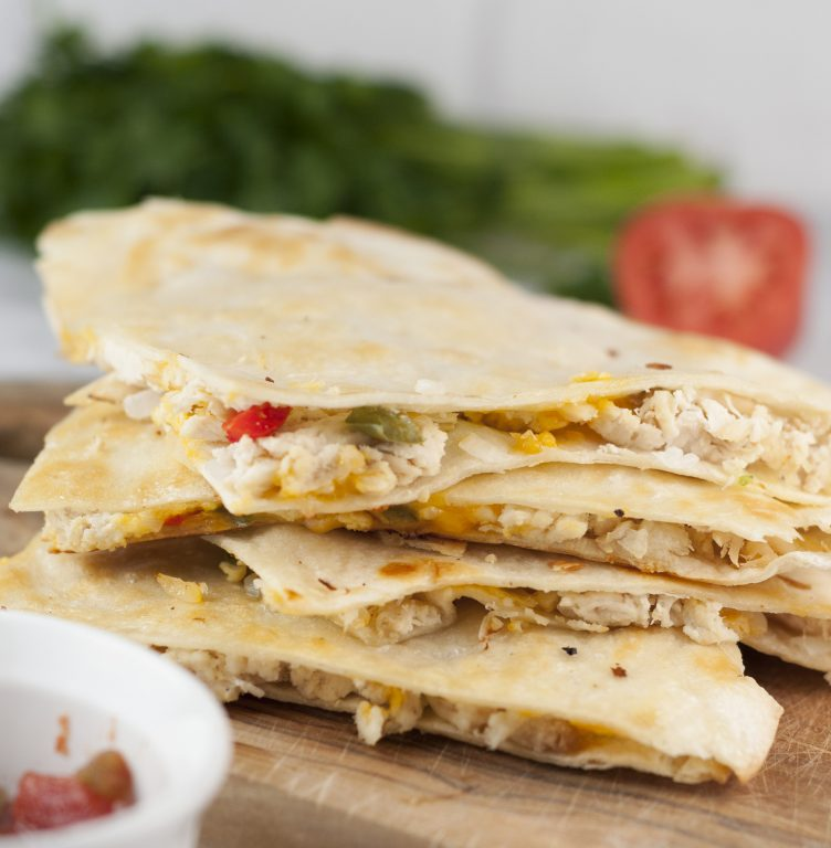 Easy Chicken Fajita Quesadillas are the perfect weeknight meal recipe and great for Mexican food night! They're so easy to make right at home and you'll love this twist on the traditional authentic Mexican quesadilla.