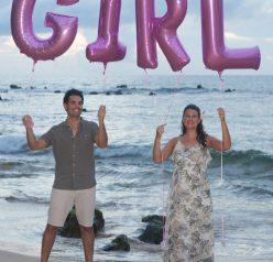 Official Gender Reveal photo we took on the beach in Maui, Hawaii with balloons.