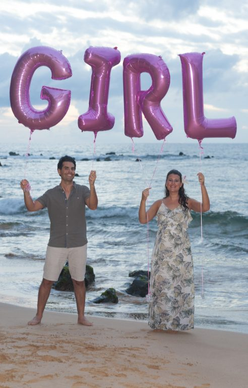 Official Baby Gender Reveal photo we took on the beach in Maui, Hawaii with balloons.