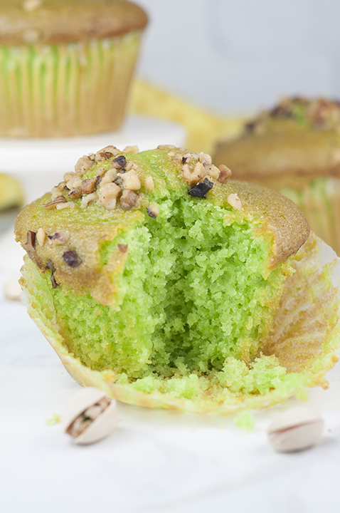 Easy, moist Green Walnut Pistachio Muffins recipe that is great for St. Patrick's day breakfast, dessert, or Easter brunch idea! You'll love that special crunch from the nuts on top!