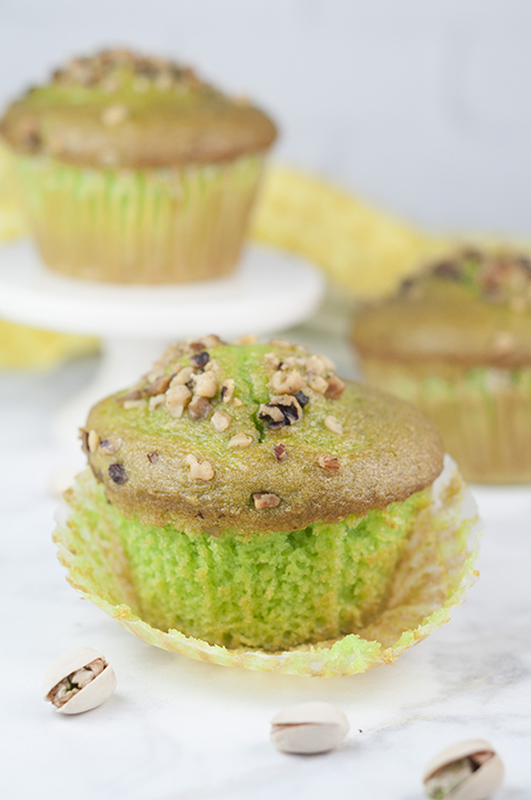 Easy, moist Green Walnut Pistachio Muffins recipe that is great for St. Paddy's day breakfast, dessert, or Easter breakfast and brunch idea! You'll love that special crunch from the walnuts on top!