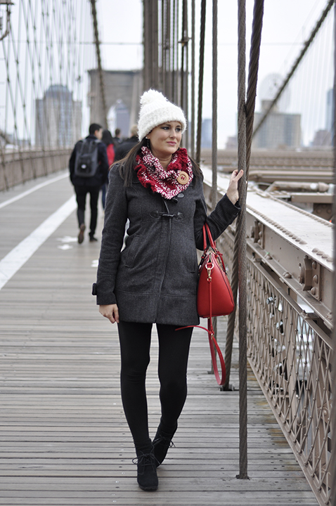 Photo walking across the Brooklyn Bridge in NYC at 12 weeks pregnant. If you're ever wondering Where to Eat and What to do in New York City when you're traveling, you've come to the right place. I'll tell you all my favorite restaurants in NYC and the best things to do with your family while in the city.
