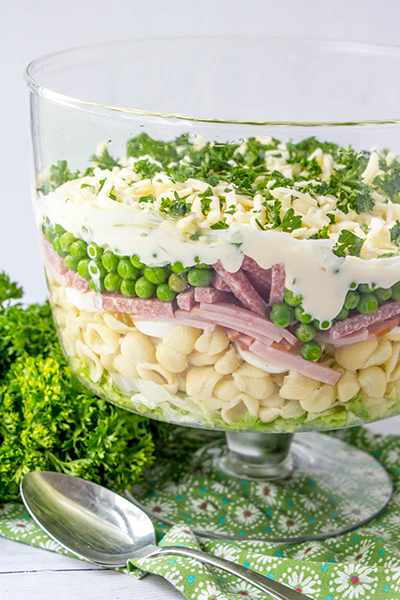 Gorgeous Make-Ahead Eight Layer Salad recipe for the most foolproof, colorful salad great for entertaining, potlucks, or summer picnic side dish idea! It is so easy and you can make it ahead of time for a party or Father's Day BBQ!