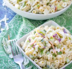 Easy Macaroni Coleslaw Salad is packed with colorful vegetables and pasta and a beautiful combination of your two favorite summer side dishes: coleslaw and macaroni salad! This is a great, easy recipe to take to a potluck, picnic or BBQ. Perfect for Labor Day!