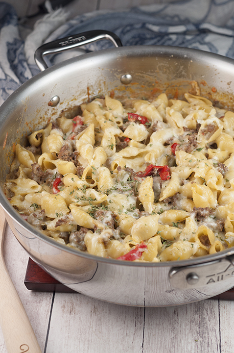 An easy dinner recipe for Philly Cheesesteak Pasta is a cheesy comfort food dish loaded with cheese and peppers that will become a new family favorite!