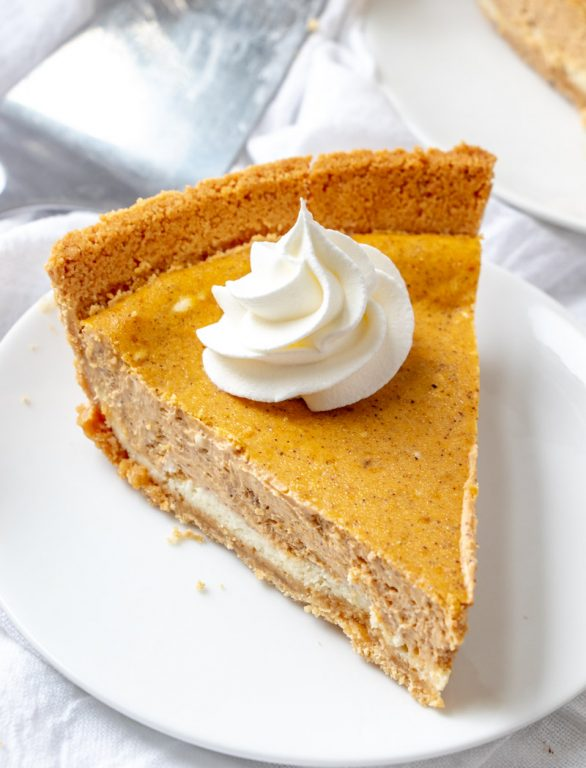 Easy, Creamy Double Layer Pumpkin Cheesecake recipe is a fall classic, and great alternative to pumpkin pie, especially for those cheesecake fans out there! This is the perfect fall, Thanksgiving, and Christmas dessert!
