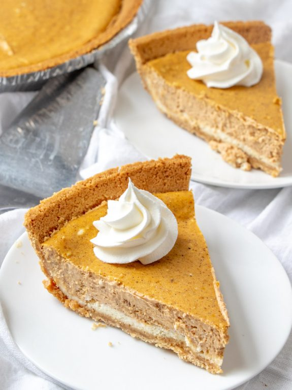 Easy Double Layer Pumpkin Cheesecake recipe is a fall classic, and great alternative to pumpkin pie, especially for those cheesecake fans out there! This is the perfect fall, Thanksgiving, and Christmas dessert!