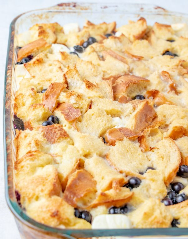 Easy, classic Overnight Blueberry French Toast Casserole is the perfect breakfast or brunch dish that makes for a beautiful presentation and tastes as good as it looks! This is great for an easy potluck recipe, dish to pass at a baby shower, or a holiday brunch or breakfast idea!