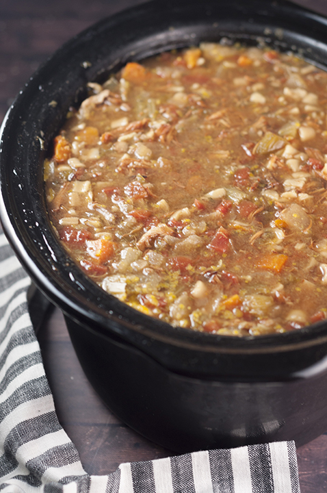 An easy copy-cat recipe for Carrabba's Italian Grill, this slow Cooker Sicilian Chicken Soup is a hearty comfort food Italian soup recipe for the fall and winter! You will love it because it's made right in the crock pot, loaded with vegetables and pasta!