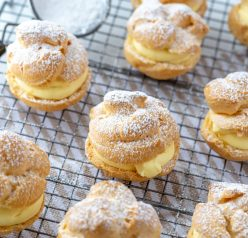 My famous Homemade Cream Puffs recipe: light and airy cream puffs filled with vanilla pudding cream are always a hit with family and anyone I've served them to. If you want an impressive, pretty dessert for Christmas or any holiday, this one is it!