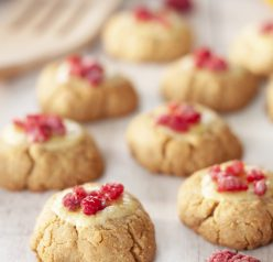 New York Raspberry Cheesecake Cookies recipe perfect for Valentine's Day or any holiday dessert! Your favorite dessert made into perfectly balanced sweet and tart cookies with fresh raspberries on top.