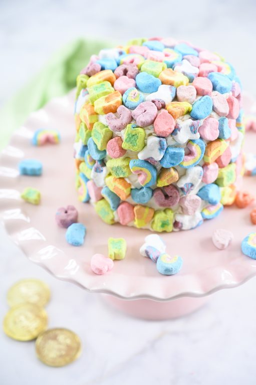 Easy Lucky Charms Layer Cake is such a fun dessert recipe that kids can help make for Saint Patrick's Day! Moist vanilla cake with vanilla buttercream frosting is a versatile recipe you can use for any birthday or special occasion.
