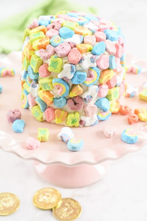 Easy Lucky Charms Layer Cake is such a fun dessert recipe that kids can help make for Saint Patrick's Day! Moist vanilla cake with vanilla buttercream frosting is a versatile recipe you can use for any birthday party or a holiday.