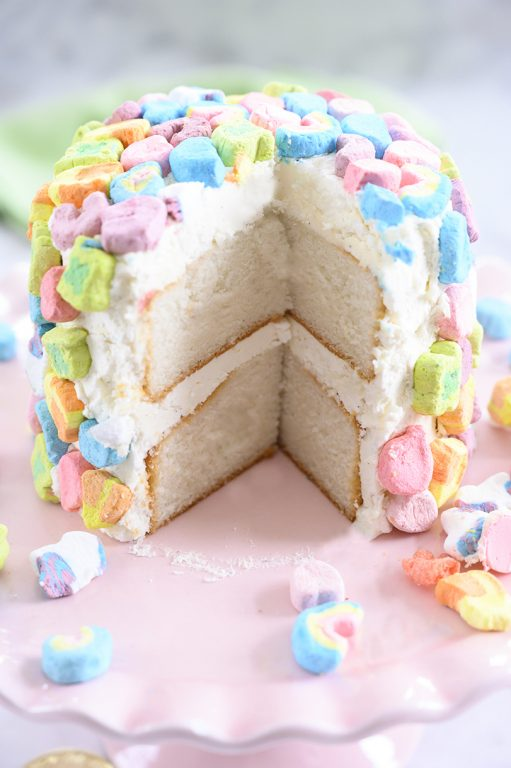 Lucky Charms Layer Cake is such a fun dessert recipe that kids can help make for St. Patrick's Day! Moist vanilla cake with vanilla buttercream frosting is a versatile recipe you can use for any birthday or special occasion.