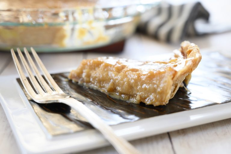 Beyond simple Salted Honey Pie recipe is an inviting sweet and salty flavored dessert with an irresistible custard filling, perfect flakey pie crust, and is absolutely perfect for Easter dessert or holiday brunch!