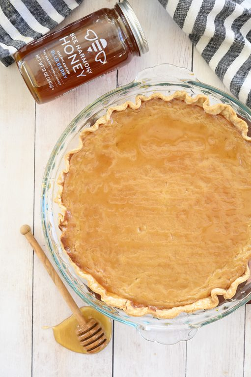 Easy Salted Honey Pie recipe is an inviting sweet and salty flavored dessert with an irresistible custard filling, perfect flakey pie crust, and is absolutely delectable!