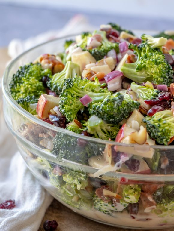 Easy, BEST Bacon and Apple Broccoli Salad is the perfect side dish, potluck or summer picnic side dish loaded with bacon, almonds, and sweet apples! You can make this ahead of time with the homemade dressing in only twenty minutes!