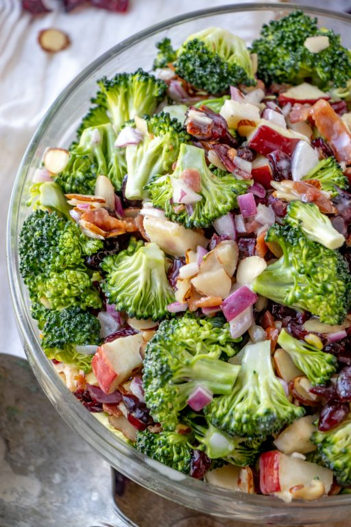 Simple Bacon and Apple Broccoli Salad is the perfect side dish, potluck or summer picnic side dish loaded with bacon, almonds, and sweet apples! You can make this ahead of time with the homemade dressing in only twenty minutes!