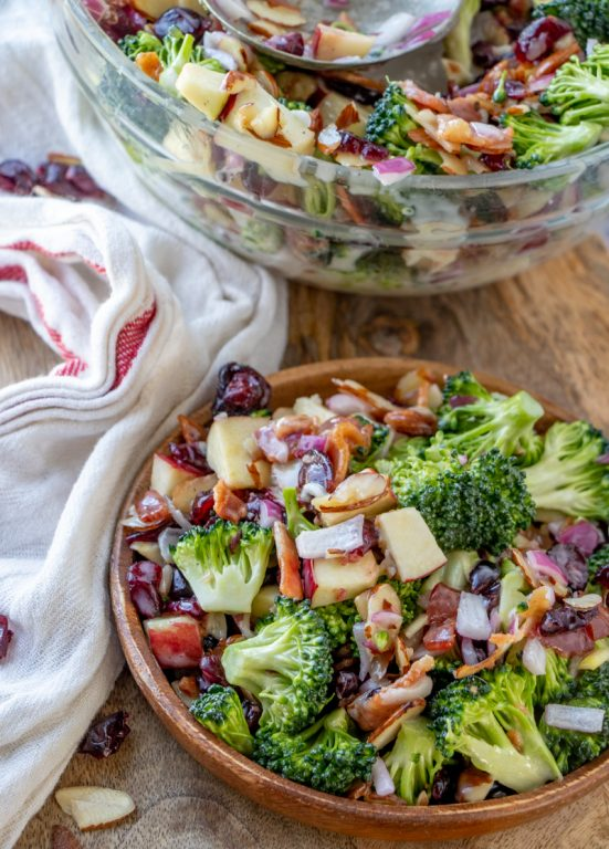 Bacon and Apple Broccoli Salad is the perfect potluck or summer picnic side dish loaded with bacon, almonds, and sweet apples! You can make this ahead of time with the homemade dressing in less than 20 minutes.