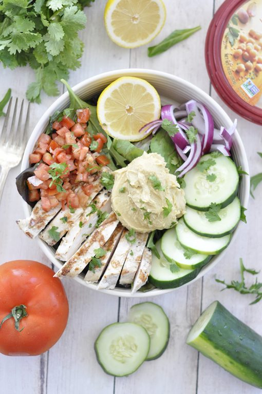 Power Chicken Hummus Bowl is a cross between a salad and a bowl and is a healthy Mediterranean-inspired recipe perfect for lunches or easy weeknight dinners!