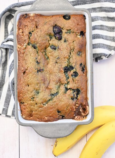 Golden, moist Blueberry Banana Bread recipe is the perfect combination for a snack, brunch or breakfast! You'll never need another banana bread recipe ever again!