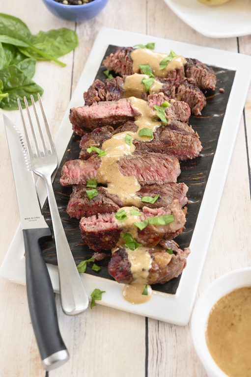 Simple Grilled Ribeye Steak with Onion Blue Cheese Sauce recipe is absolutely delicious and the perfect choice for a summer cookout! No need to go to your local expensive steakhouse when you can make it easily right at home this summer!