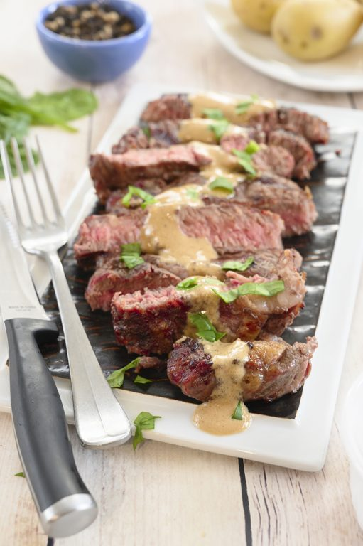 Grilled Ribeye Steak with Onion Blue Cheese Sauce recipe is absolutely divine and the perfect choice for a summer cookout! No need to go to your local steakhouse when you can make it easily right at home!