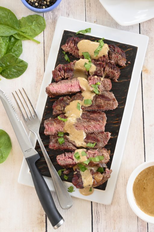 Easy Grilled Ribeye Steak with Onion Blue Cheese Sauce recipe is absolutely divine and the perfect choice for a summer cookout! No need to go to your local steakhouse when you can make it easily right at home!