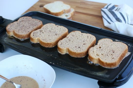 Cooking French Toast on a kitchen griddle.