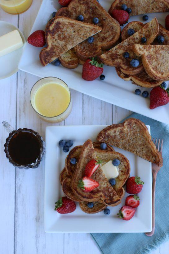 Overhead view of french toast with fruit- strawberries and blueberries.