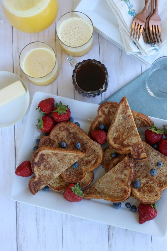 Overhead view of french toast with strawberries and blueberries.