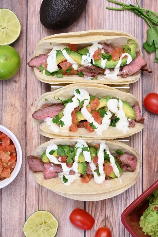 Medium-rare Grilled Flank Steak Tacos with Avocado and Cilantro Lime Crema is easy to prepare during a weeknight or on weekends! This grilled beef recipe with a Mexican twist is wonderful for beginners and experts alike.