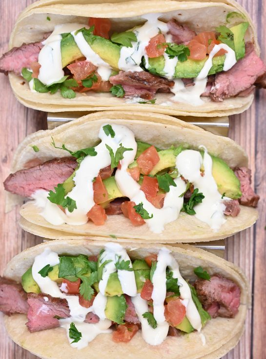 Easy Grilled Flank Steak Tacos with Avocado and Cilantro Lime Crema is easy to prepare during a weeknight or on weekends! This grilled beef recipe with a Mexican twist is wonderful for beginners and experts alike.