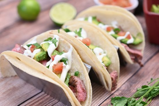 Tender, juicy Grilled Flank Steak Tacos with Avocado and Cilantro Lime Crema is easy to prepare during a weeknight or on weekends! This grilled beef recipe with a Mexican twist is wonderful for beginners and experts alike.