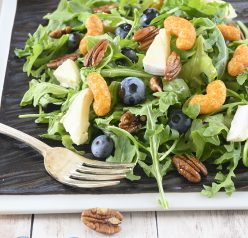 An easy, gluten-free salad recipe with fruit: Blueberry-Brie Pecan Salad with Protein Puff Croutons. The protein puffs and candied pecans add so much crunch and flavor!