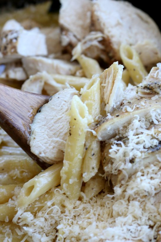 Close up view of crock pot chicken alfredo that was cooked in a slow cooker.